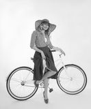 Girl with a bicycle in a retro style. Blonde girl with a bicycle in a retro style on a white background Stock Image