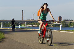 The girl on a bicycle riding Stock Photography