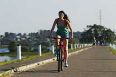 The girl on a bicycle riding Royalty Free Stock Images