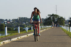 The girl on a bicycle riding Stock Photo