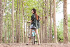 Girl With Bicycle Series. Asian Girl With Bicycle Series,Looking Back Stock Images