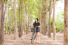 Girl With Bicycle Series. Asian Girl With Bicycle Series,Walking With Nature Royalty Free Stock Photos