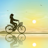 Girl on a Bicycle. A Girl on a Bicycle in Silhouette with Sunset, Sunrise royalty free illustration