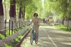 Girl on  bicycle at spring morning Stock Photo