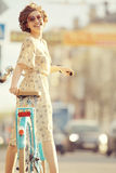 Girl on  bicycle at spring morning Stock Images
