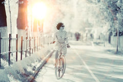 Girl on a bicycle at spring morning Royalty Free Stock Photography