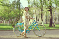 Girl on  bicycle at spring morning Stock Photography
