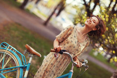 Girl on  bicycle at spring morning Royalty Free Stock Photo