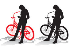 Girl with a bicycle. Girl standing with a bicycle on a walk Royalty Free Stock Photos