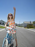 Girl With Bicycle On Street Stock Photo