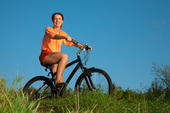The girl on a bicycle in the summer evening Royalty Free Stock Photography