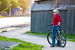 Girl with a bike Royalty Free Stock Photos