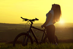 Girl with bicycle Royalty Free Stock Images
