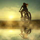 Girl on a bicycle Royalty Free Stock Photography