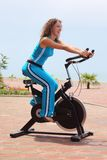 Girl on bicycle training apparatus outdoor Stock Images