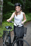 Girl before bicycle trip Royalty Free Stock Photos