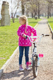 Girl and bicycle Stock Photos