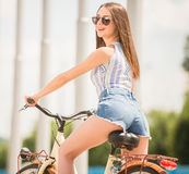 Girl on bicycle Stock Photos