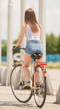 Girl on bicycle Stock Photography