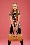 Girl with a big bag Stock Image