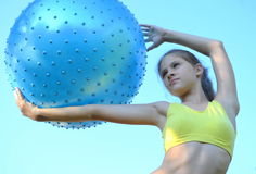 Girl with big ball for fitness Royalty Free Stock Images