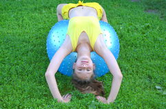 Girl with big ball for fitness Stock Image