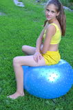 Girl with big ball for fitness Royalty Free Stock Photography