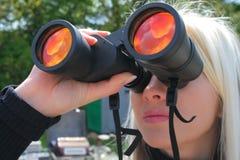 Girl with big binocular Royalty Free Stock Photography