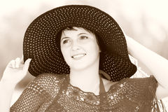 The girl in the big black hat Stock Photography