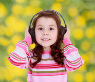 Girl with big black headphones Royalty Free Stock Photography