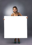 Girl with big blank Royalty Free Stock Image