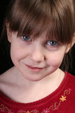Girl big blue eyes face Stock Photography