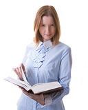 Girl with a big book. Beautiful girl with huge open book in her hands, isolated on white Stock Images