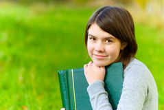 Girl with big book Royalty Free Stock Images