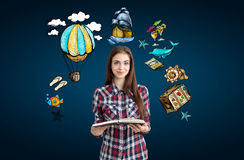 Girl with big book and travel sketches Stock Images