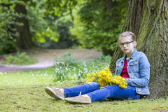 Girl with big bouquet of spring flowers Stock Photos