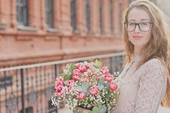 Girl with a big bouquet of tulips Stock Photo
