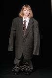 Girl in Big Business Suit Royalty Free Stock Photo