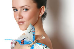 Girl with big butterfly Stock Photos