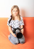 Girl with big camera Royalty Free Stock Images