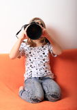 Girl with big camera Royalty Free Stock Photo