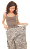 Girl into big camouflage trousers Royalty Free Stock Photo