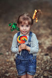 Girl with a big candy Royalty Free Stock Photo
