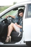 Girl in a big car. Portrait of young brunette woman sitting in her car stock photos