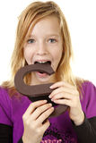 Girl with big chocolate letter Royalty Free Stock Photography