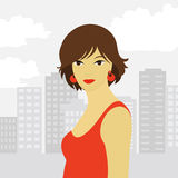 Girl in the big city. Beautiful girl on the background of the cityscape Stock Photography