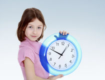 Girl with a big clock Stock Photo
