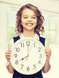 Girl with big clock Stock Image