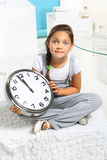 Girl with a big clock Royalty Free Stock Photography