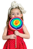 Girl with a big colorful lollipop. Close-up of a little Girl with a big colorful lollipop, white Background stock photos